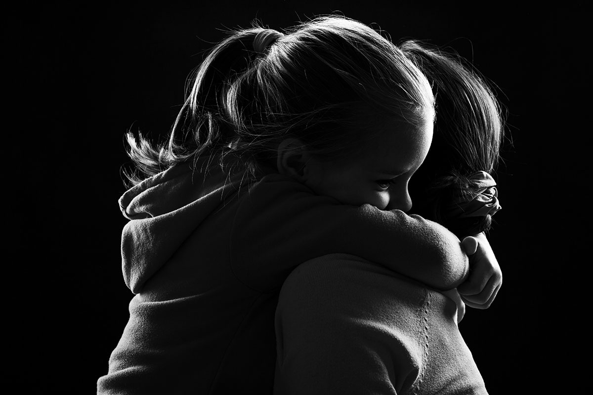 Daughter giving her mother a tight hug