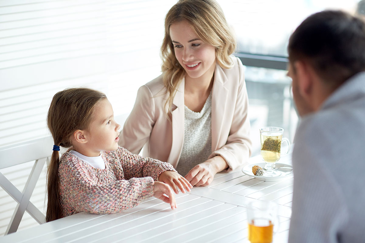 Parents talking with daughter